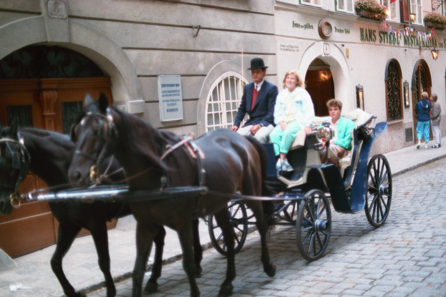 Amy, Russel and Matt in a horse-drawn carriage in Vienna, 1980s