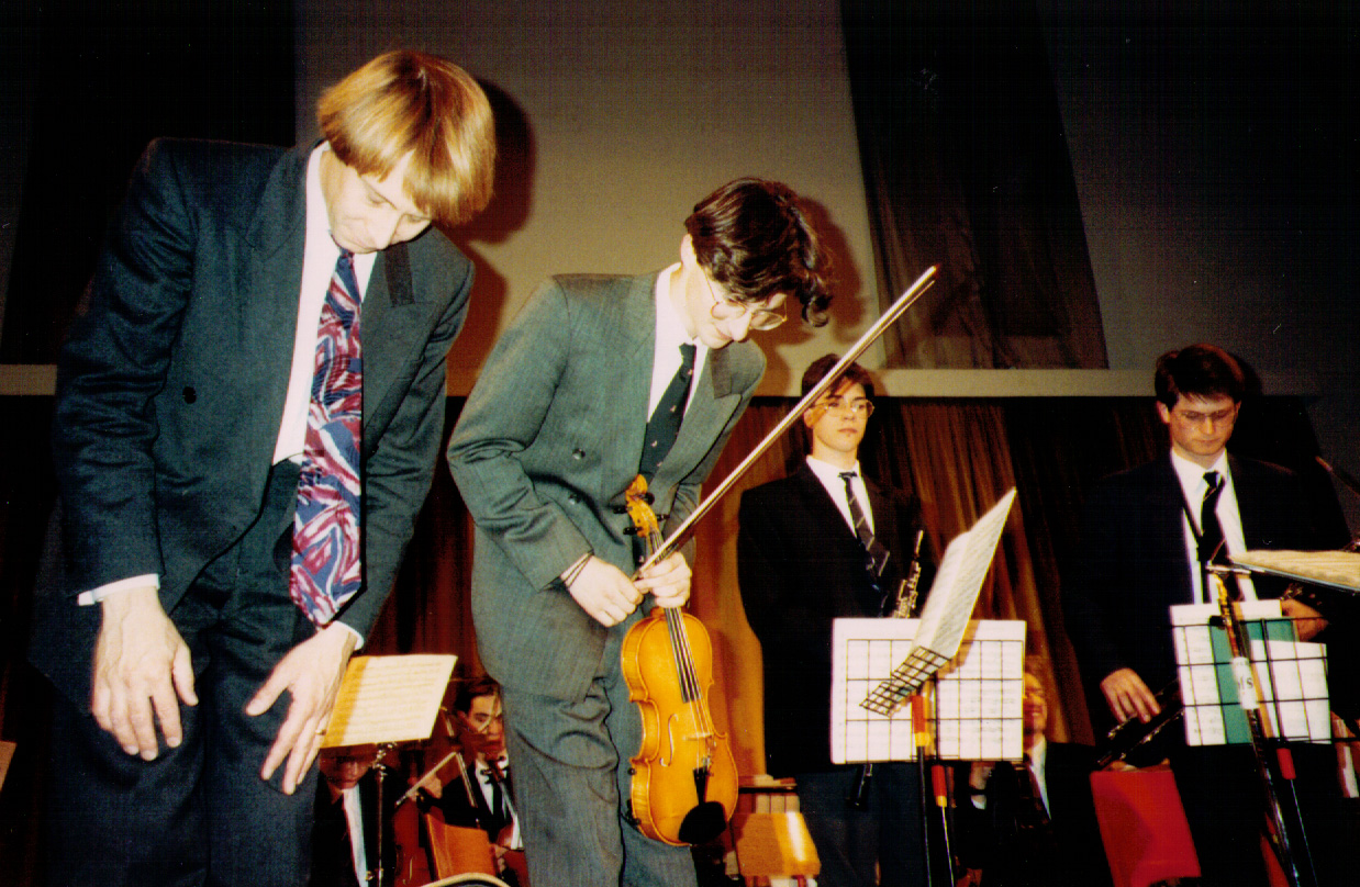 Charlie Furniss takes a bow after a Violin gig at Oundle School