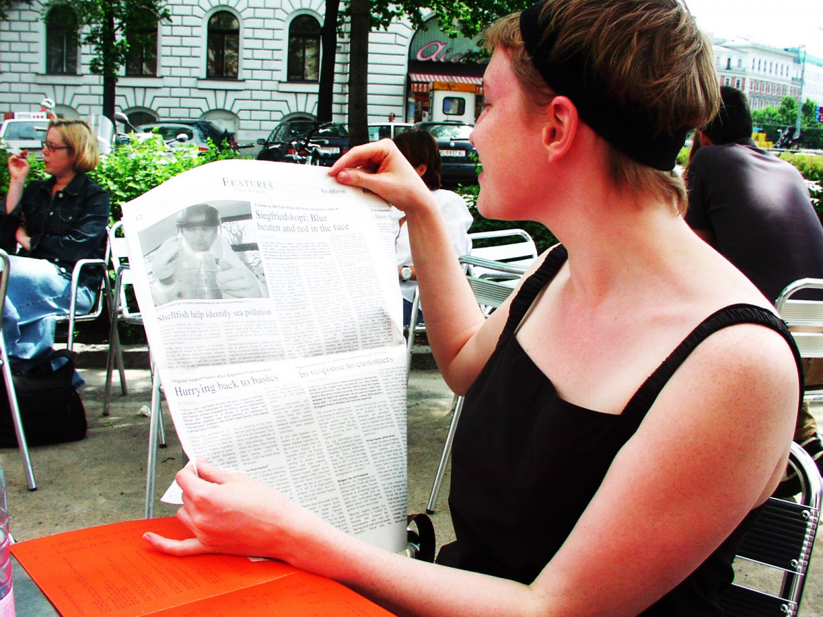 Amy reads paper