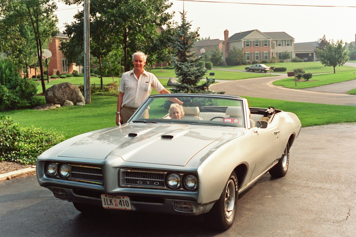 Uncle Tom Rusling and his Pontiac GTO Convertible, with Tee Tee Rusling inside