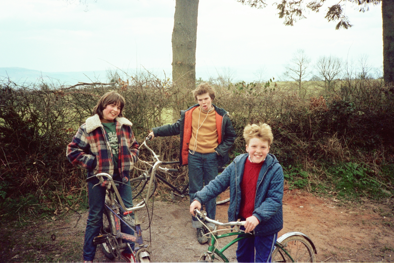 Helen Joice, Russel Shearer and Matt Shearer on their bikes, at Amberslone, 1982