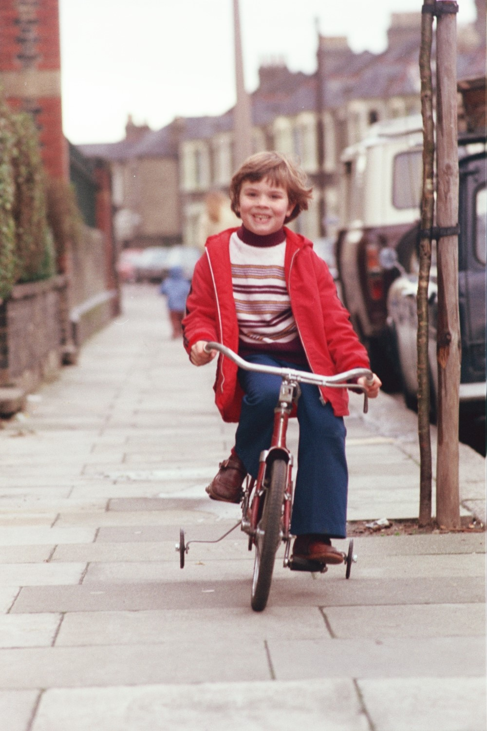 "Russel Shearer on the ""red bike"" that we all learned to ride on. Leyton, London"
