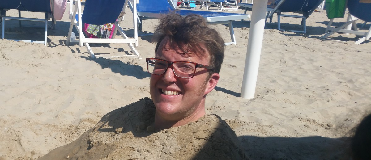 Matt Shearer in the sand, Italy