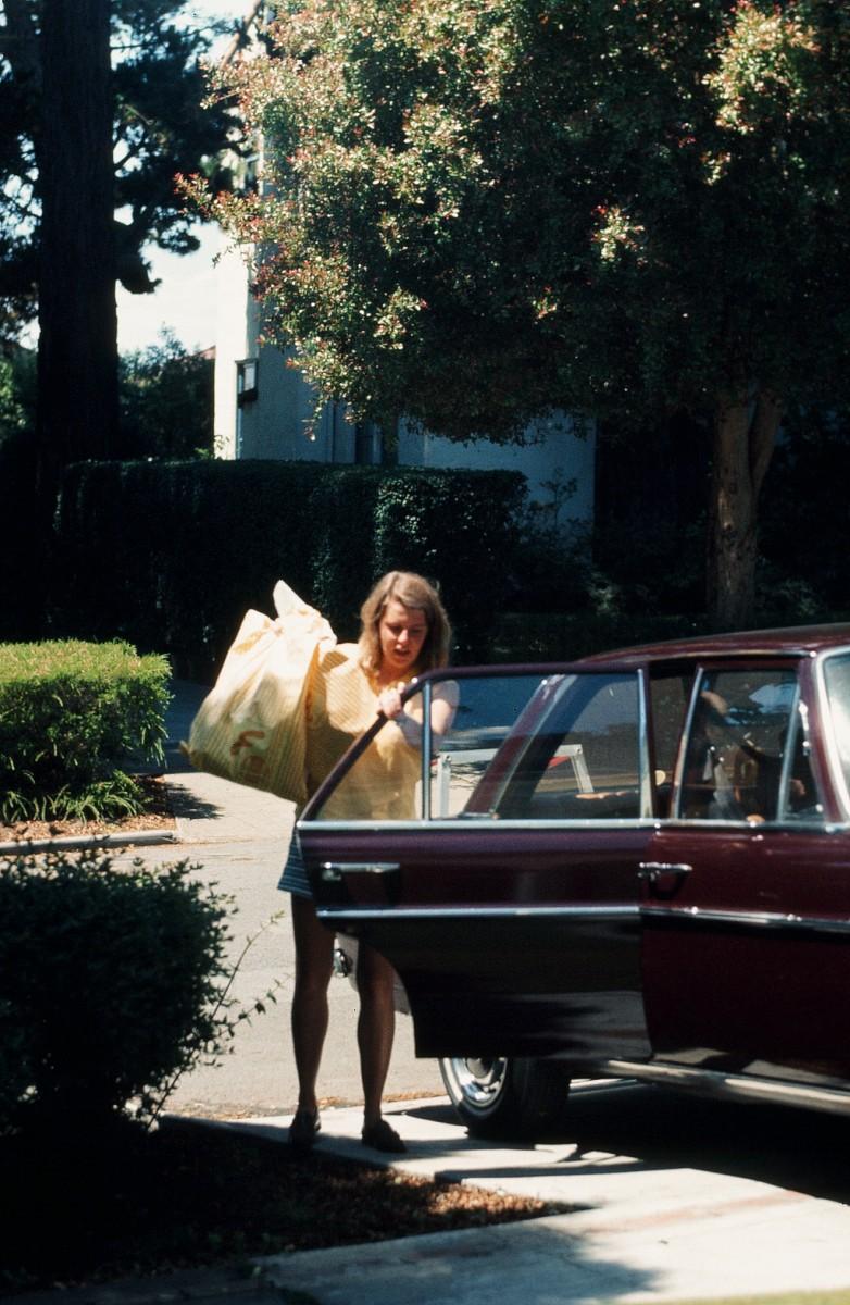 Lori Shearer unloads the Mercedes in San Francisco, 1971